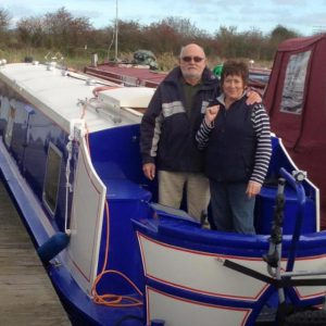 "Dave Richman and his wife on board their narrowboat ""MegAStar 2""."