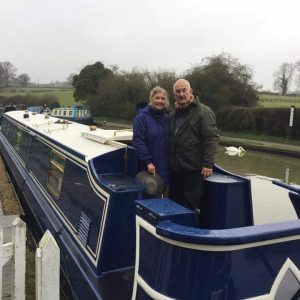"Mick and Catriona on board their narrowboat ""Nivaria""."
